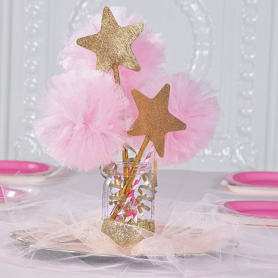 a glitter mason jar with pompoms and glitter star props