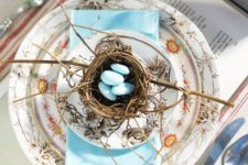 11 bold patterned plates, a nest with faux blue eggs
