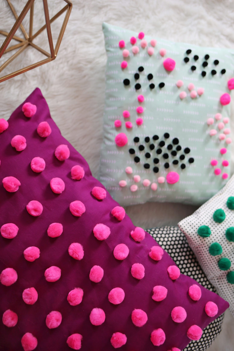 DIY mini pompom decorated pillows  (via www.abeautifulmess.com)