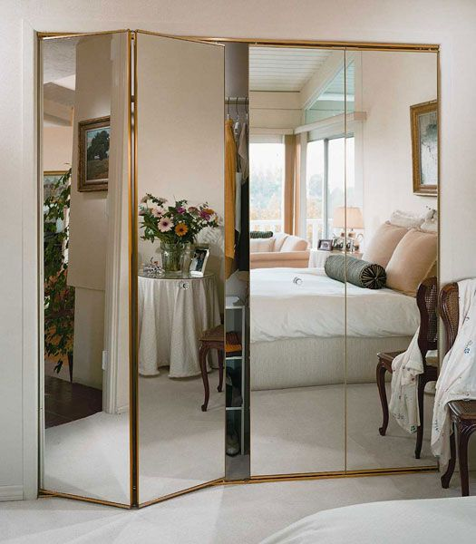 folding mirror closet doors with elegant gold framing for a girl's bedroom