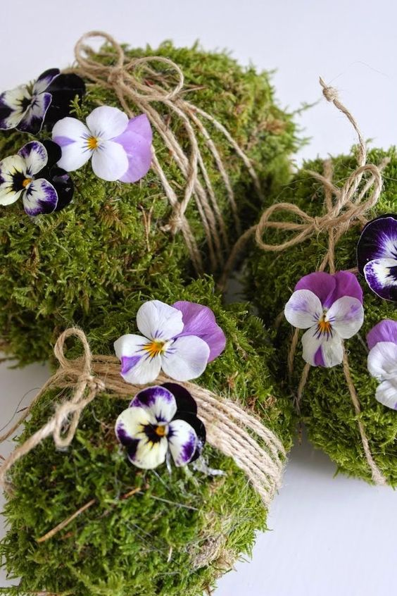 moss covered eggs with twine and pansies