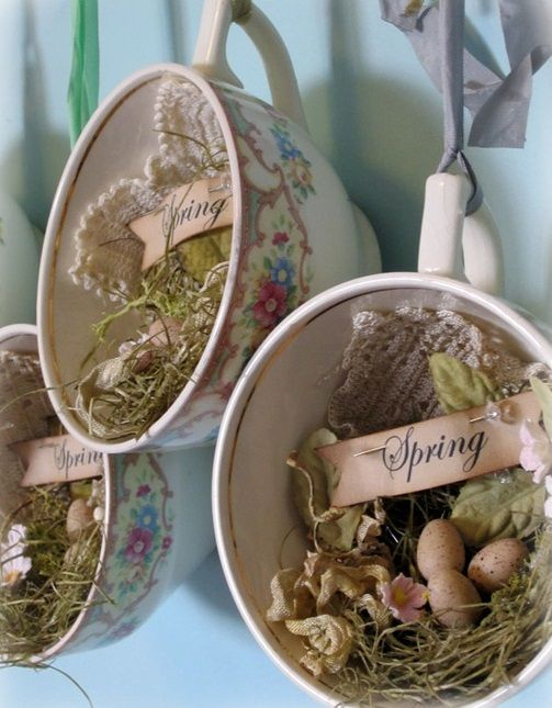 vintage cups with hay, speckled eggs, lace and paper