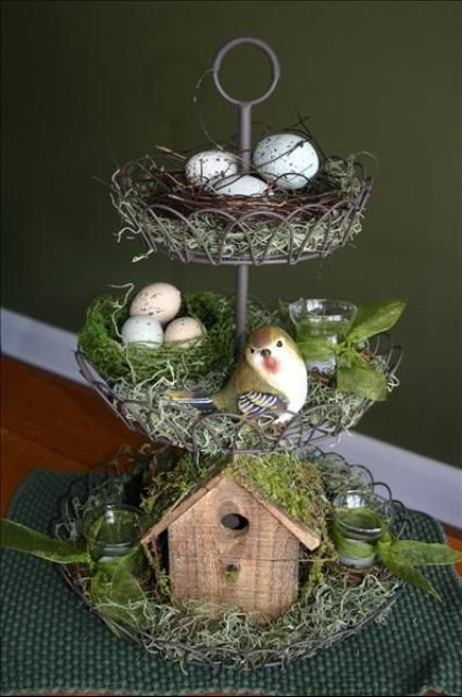 a cupcake stand with grapevine bird nests, a bird house and birds