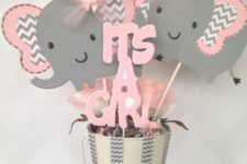 12 a pink and grey bucket centerpiece with elephant and letter props