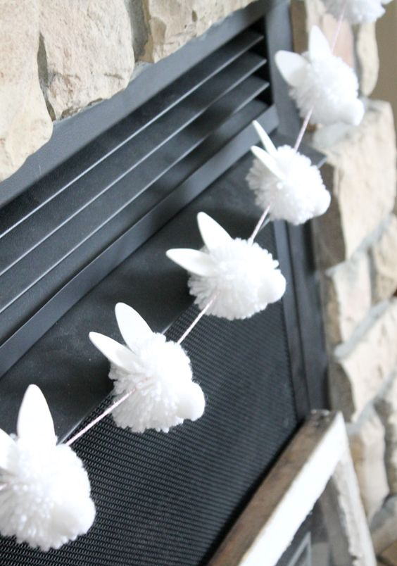 a white pompom bunny garland screams hoppy Easter