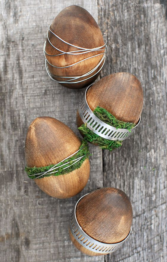 wooden Easter eggs with wire and moss look both rustic and industrial