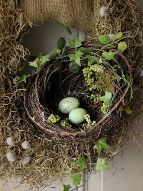 a burlap wreath with a grapevine nest, faux greenery and green eggs