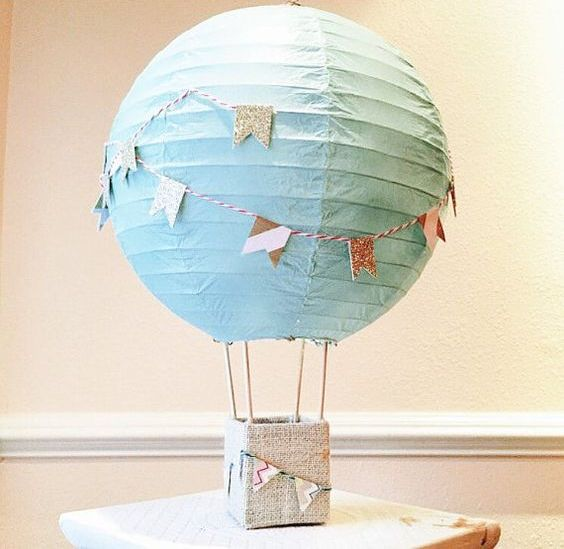 a hot air balloon centerpiece with a turquoise balloon means a boy