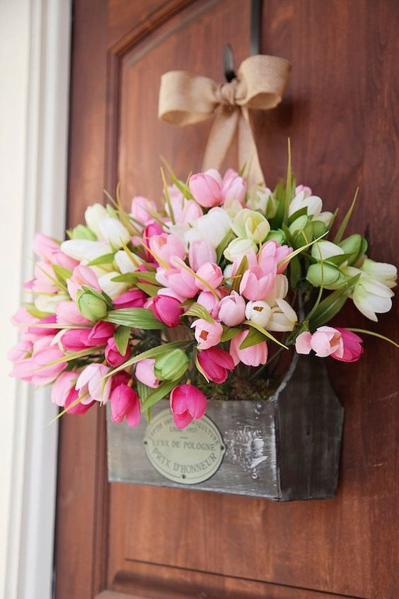 a vintage toolbox with ombre tulips and a burlap bow