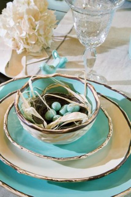 blue and white silver trim plates, a nest with faux blue eggs