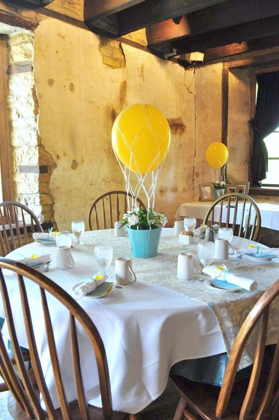 hot air balloon centerpieces with blue pots and white flowers