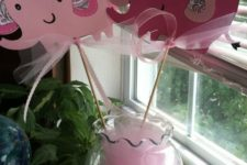 13 pink elephant props in a vase are a very easy idea