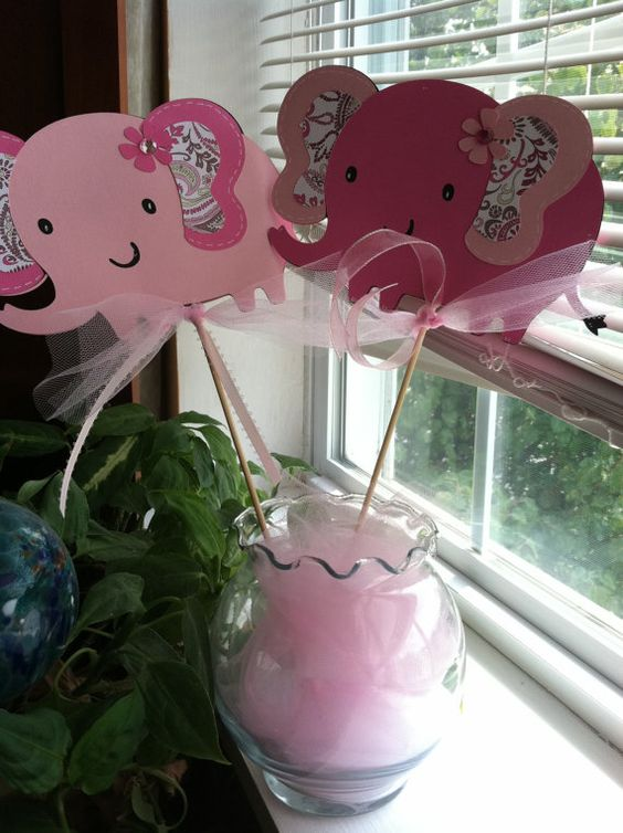 pink elephant props in a vase are a very easy idea