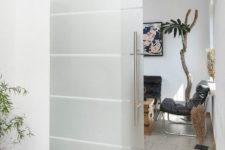 13 stainless steel sliding glass barn door for a modern space