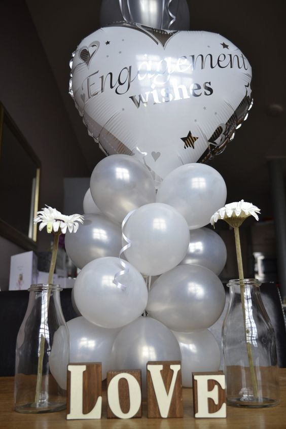 white balloons installation for an engagement party