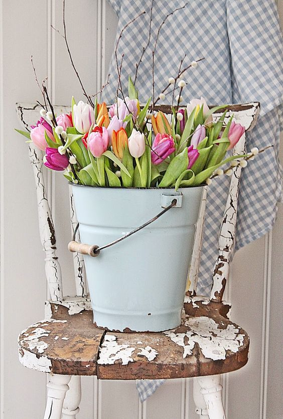 a bucket with colorful tulips will scream spring
