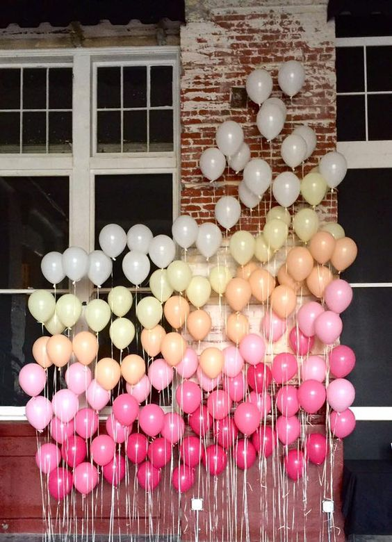 a fun ombre balloon backdrop is ideal for any party