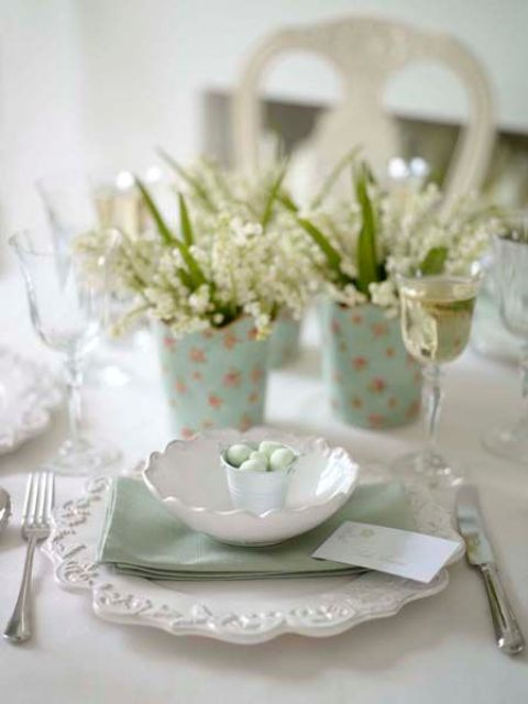 a lace platter, a mint napkin and a bowl with a bucket with tiny mint eggs