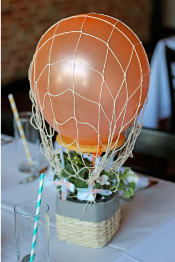 colorful hot air balloon centerpieces at carnival-themed baby shower