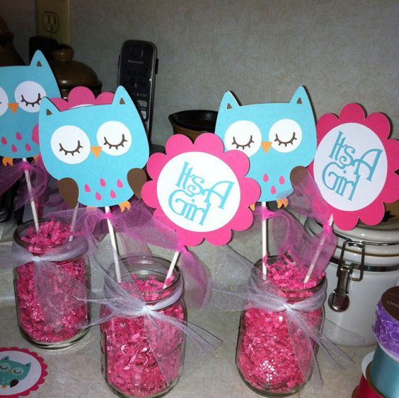 letters and owl props in mason jars with pink confetti