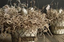 14 nest baskets with faux eggs and branches for rustic and industrial decor