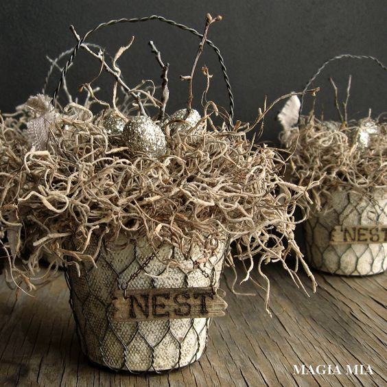 nest baskets with faux eggs and branches for rustic and industrial decor