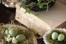 15 a faux nest on a dish, moss and green speckled eggs