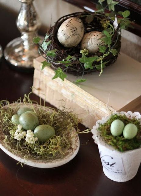 a faux nest on a dish, moss and green speckled eggs