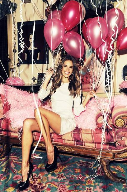 a lot of hot pink balloons for a party feel