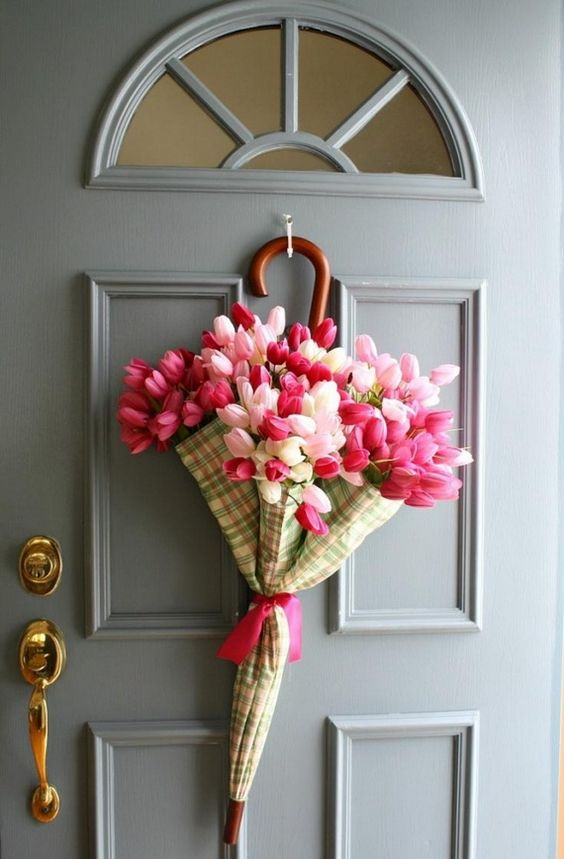 an umbrealla with colorful tulips instead of a wreath