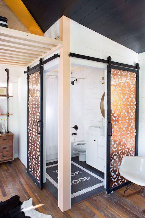 copper glass doors in black framing