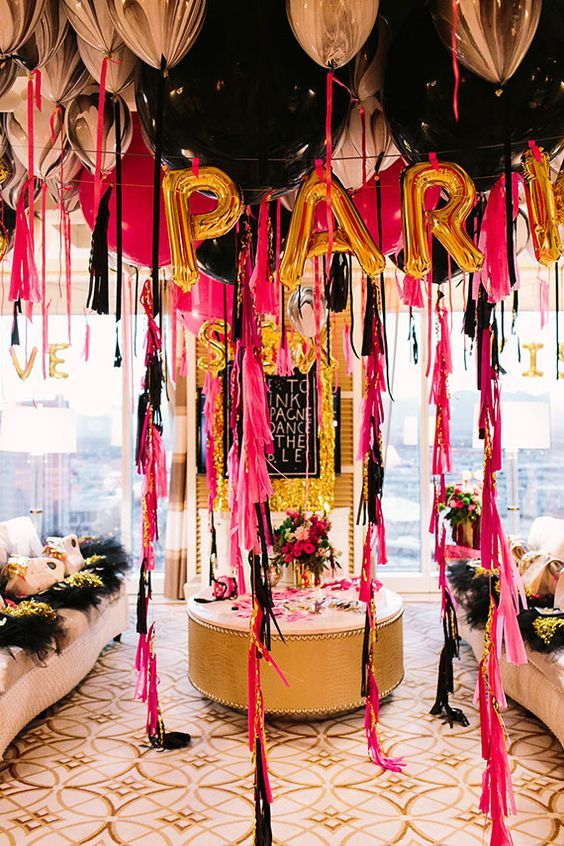 lots of black, pink and marble balloons with bold tassels