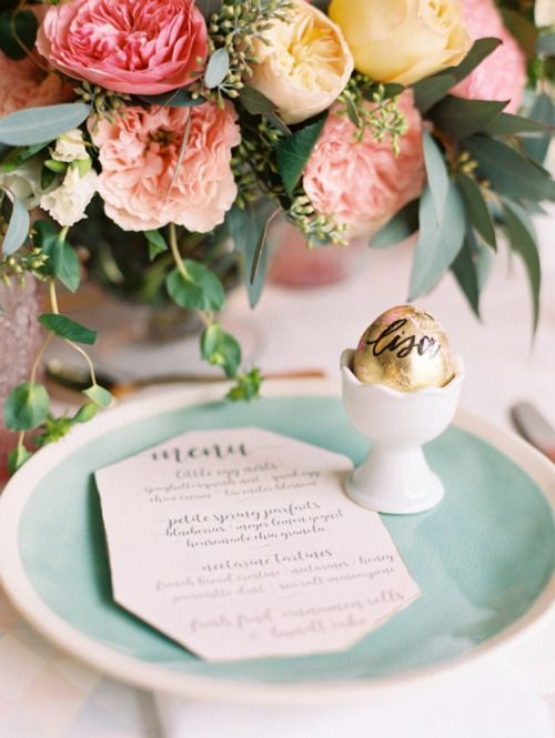 a mint plate and a gold egg in a cup
