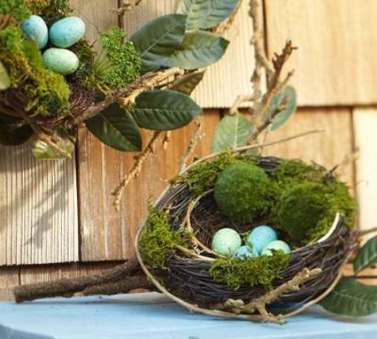a nest with moss, leaves and blue eggs for Easter decor