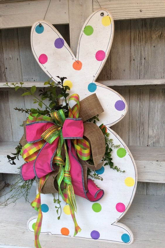 a polka dot bunny sign with a large bow of burlap and colorful ribbon