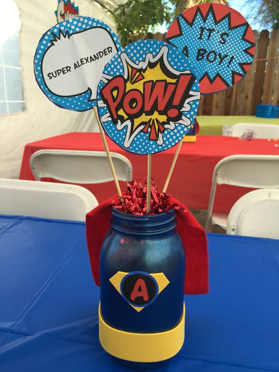 a super hero themed centerpiece with comics details