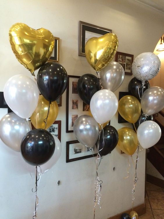 black, white, gold and silver balloons for an elegant party