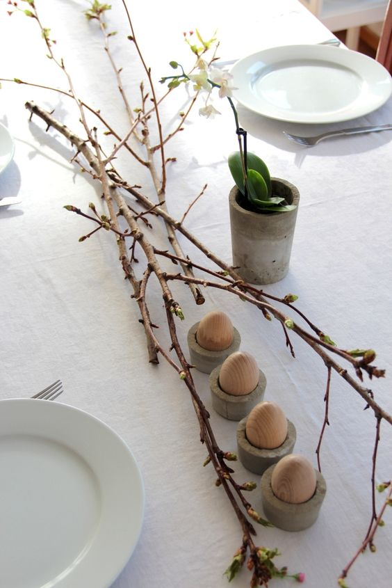 branches, concrete egg bunkers and a vase with a bloom