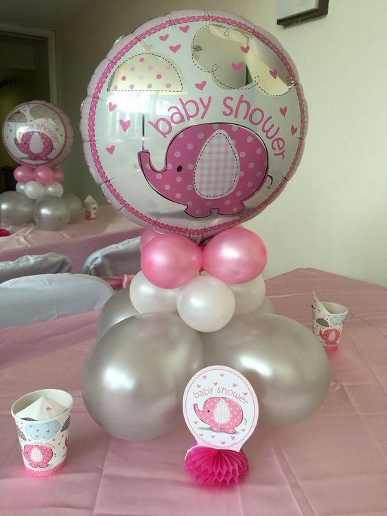 grey, white and pink balloons with a giant elephant one
