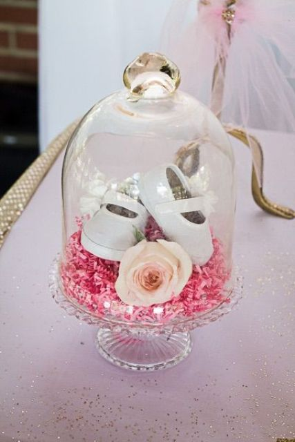 a cloche with a rose, pink confetti and sandals