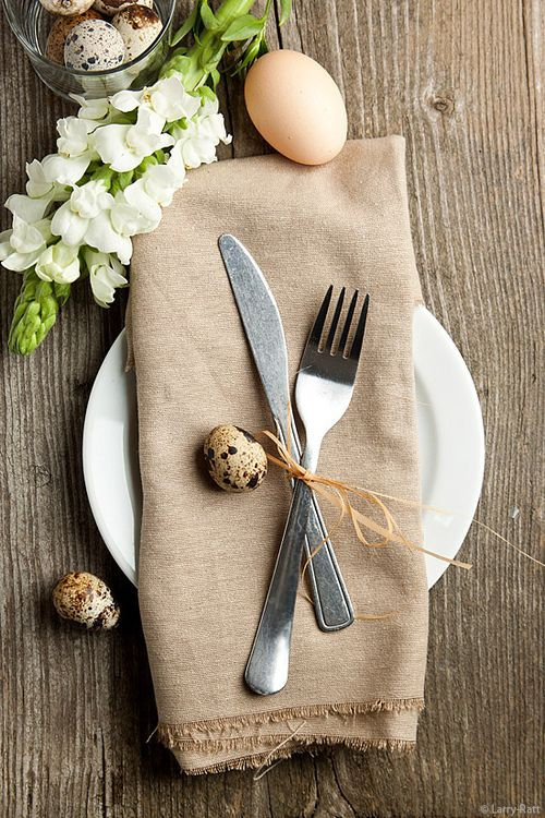 a neutral napkin and some speckled eggs