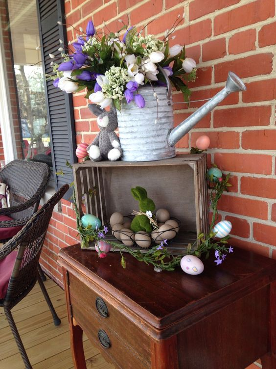 bold spring flowers in a watering can and egg arrangements