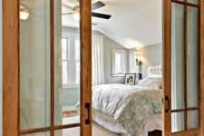 17 warm wood barn doors with glass panes are cozy and stylish