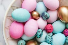 18 bold pink and blue Easter eggs and small speckled ones