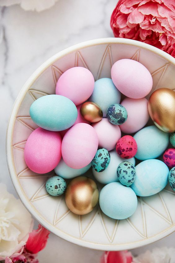 bold pink and blue Easter eggs and small speckled ones