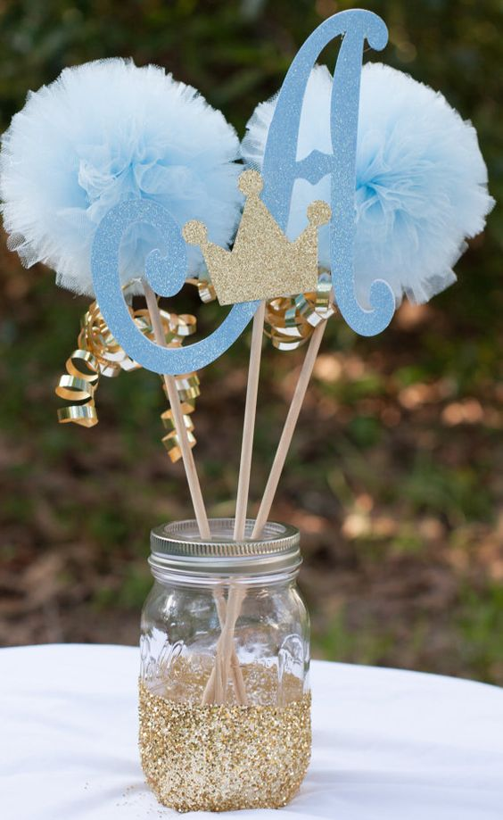 glitter mason jar with paper pompoms and glitter crowns for a prince-themed party
