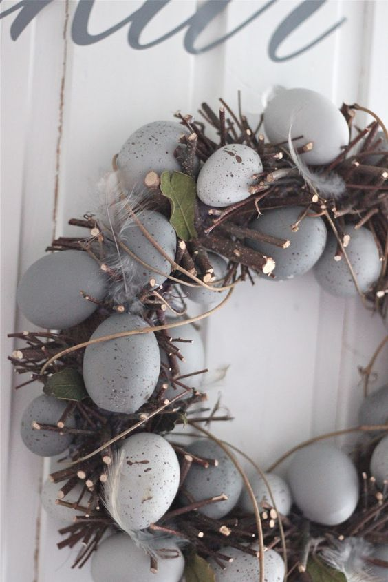 grey speckled eggs and branches for a wreath