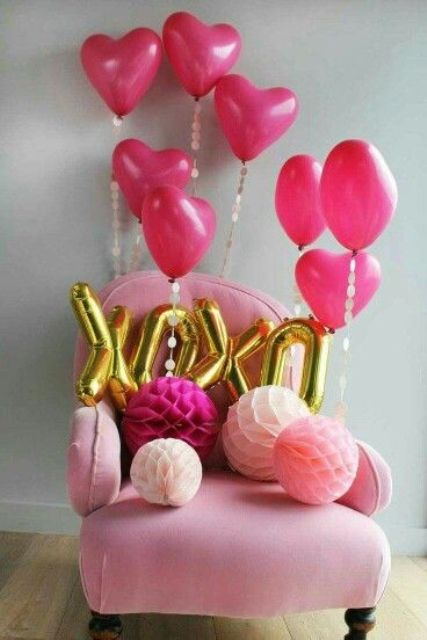 pink heart-shaped balloons and XOXO letters for party decor