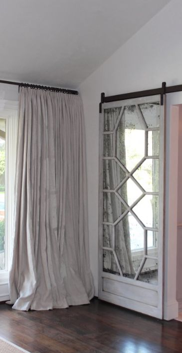 refined mirror barn door with framing