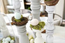 18 table decor with eggs on stands, moss and nests
